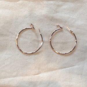 Francesca's large rose gold hoop earrings